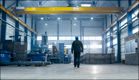 Factory worker walking through industrial facility