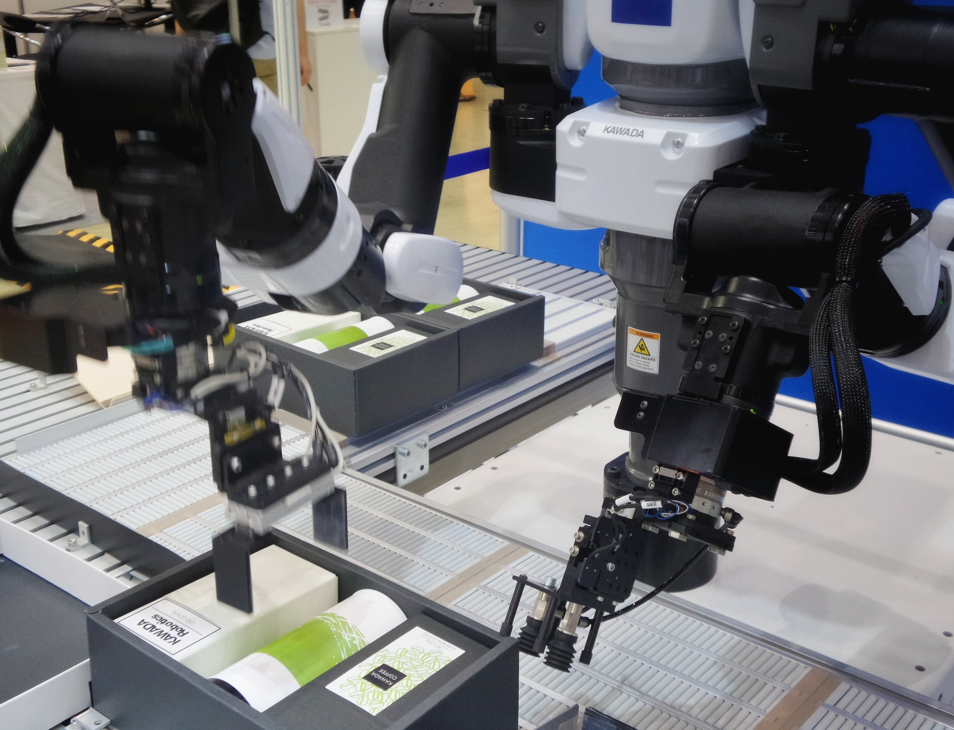 Robotic arms working on a box